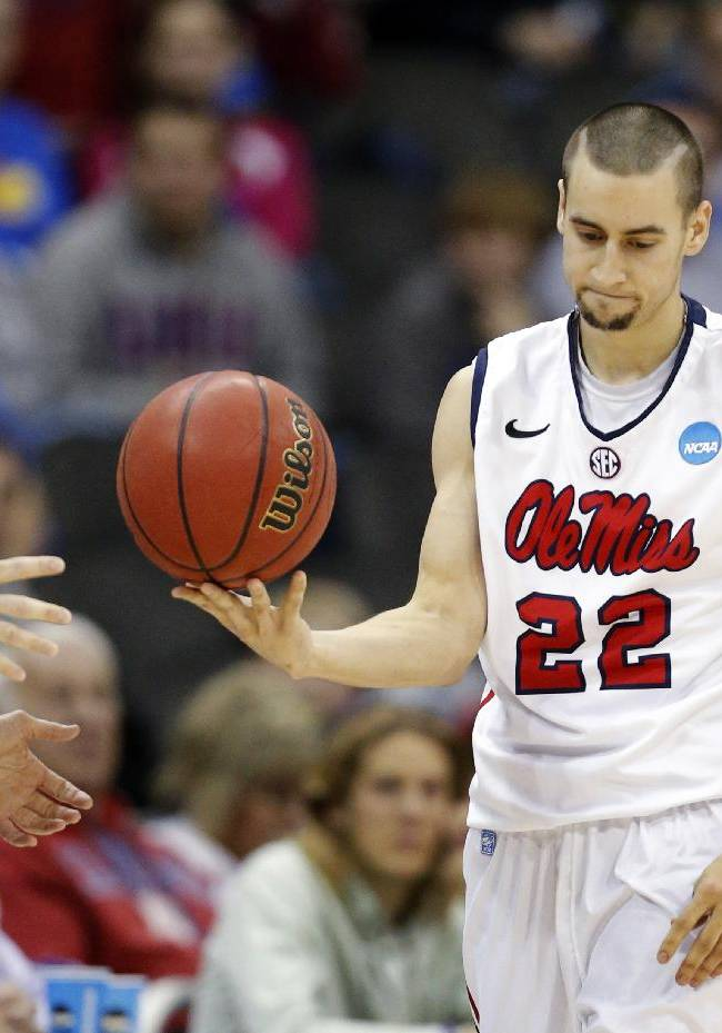 Mississippi guard Marshall Henderson (22) hands the ball to a referee during the first half of a third-round game against La Salle in the NCAA college basketball tournament at the Sprint Center in Kansas City, Mo., Sunday, March 24, 2013