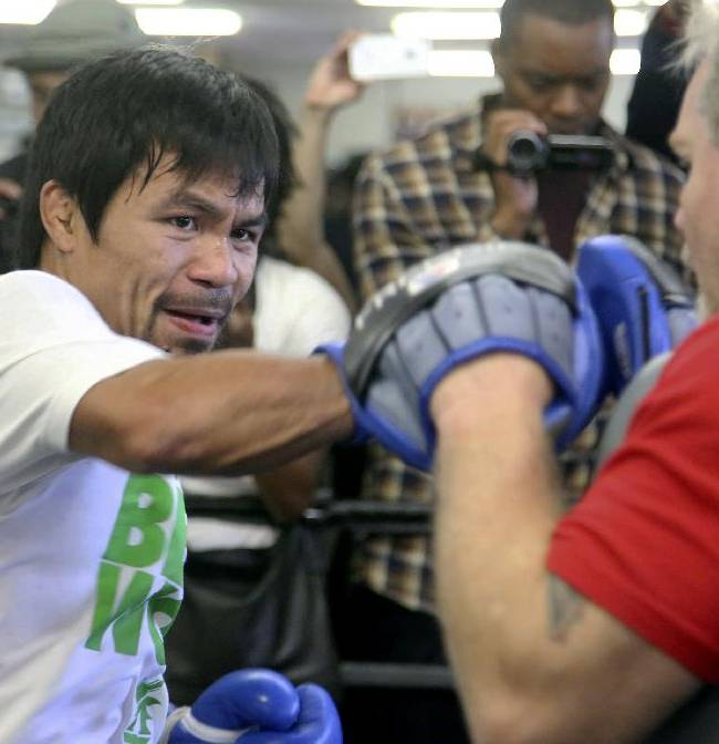 Manny Pacquiao is shown training with coach Freddie Roach Wednesday April 2, 2014 at the Wild Card Boxing Club in Los Angeles. Pacquiao is scheduled to fight Timothy Bradley April 12 in a WBO Welterweight title bout
