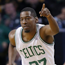 Boston Celtics' Jordan Crawford (27) reacts after scoring in the first quarter of an NBA basketball game against the Denver Nuggets in Boston, Friday, Dec. 6, 2013. The Celtics won 106-98 The Associated Press