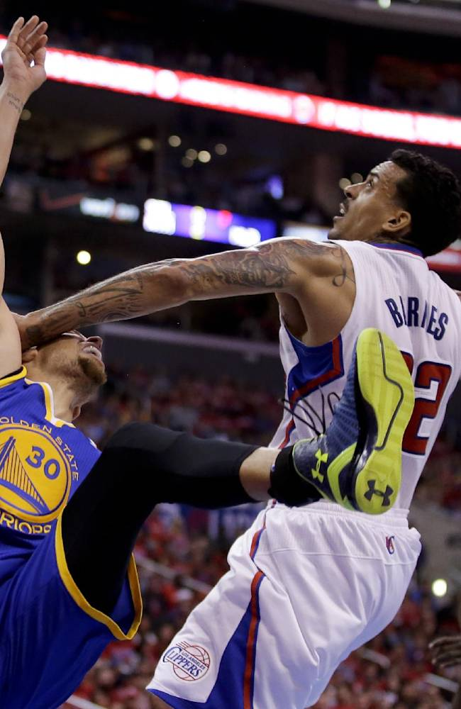Los Angeles Clippers forward Matt Barnes, right, fouls Golden State Warriors guard Stephen Curry during the second half in Game 2 of an opening-round NBA basketball playoff series in Los Angeles, Monday, April 21, 2014