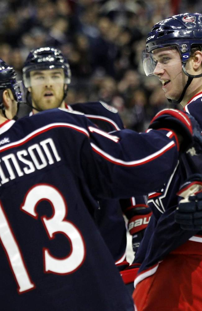 Columbus Blue Jackets' Ryan Murray, right, is congratulated by teammate Cam Atkinson after Murray scored a goal against the New York Islanders in the second period of an NHL hockey game in Columbus, Ohio, Sunday, April 6, 2014. The Blue Jackets won 4-0