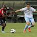 Cagliari's Victor Ibarbo, left, and Lazio's Senad Lulic challenges for the ball during a Serie A soccer match between Cagliari and Lazio, at the Nereo Rocco Stadium in Trieste, Italy, Sunday, May 19, 2013