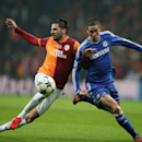 Hakan Balta of Galatasaray, left, and Fernando Torres of Chelsea fight for the ball during their Champions League Round of 16, First Leg soccer match between Galatasaray and Chelsea at Turk Telekom Arena Stadium in Istanbul, Turkey, Wednesday, Feb. 26, 20