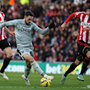 Burnley's Danny Ings, center, vies for the ball with Sunderland's Santiago Vergini, right, and John O'Shea, left, during their English Premier League soccer match between Sunderland and Burnley at the Stadium of Light, Sunderland, England, Saturday, Jan.