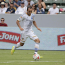 In this Saturday, Aug. 2, 2104 photo, Los Angeles Galaxy's Landon Donovan controls the ball during the second half of an MLS soccer match against Portland Timers in Carson, Calif. Donovan says he will retire from professional soccer at the end of the MLS