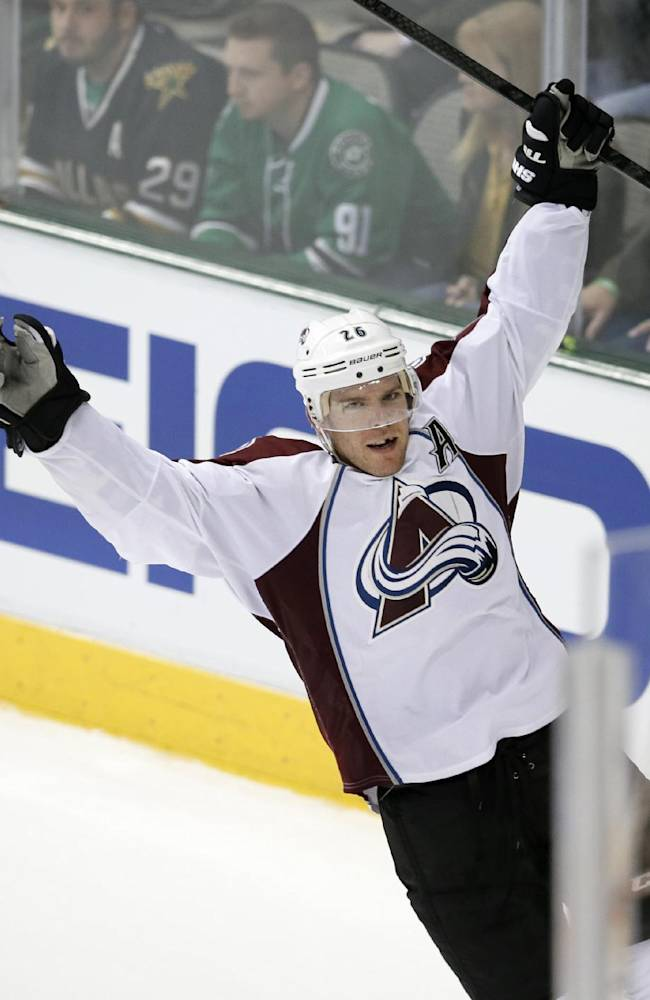Colorado Avalanche center Paul Stastny celebrates his goal against the Dallas Stars in overtime of an NHL hockey game, Friday, Nov. 1, 2013, in Dallas. Stastny also scored in the first period of the 3-2 Avalanche win
