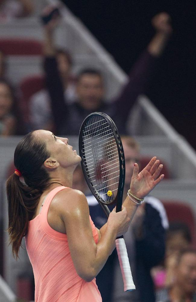 Jelena Jankovic of Serbia reacts after defeating Petra Kvitova of the Czech Republic during the semifinal of the China Open tennis tournament at the National Tennis Stadium in Beijing, China Saturday, Oct. 5, 2013