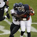 Chicago Bears running back Michael Ford, right, is tackled by Baltimore Ravens safety James Ihedigbo (32) during the first half of an NFL football game, Sunday, Nov. 17, 2013, in Chicago The Associated Press