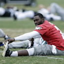 Philadelphia Eagles quarterback Michael Vick stretches after practice at the NFL football team's training facility, Thursday, Dec. 5, 2013, in Philadelphia The Associated Press