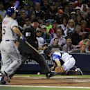 Atlanta Braves catcher Evan Gattis, right chases down a wild pitch by Aaron Harang as New York Mets' David Wright, left, calls for teammate Ruben Tejada to score on the play in the third inning of baseball game, Tuesday, April 8, 2014, in Atlanta The Asso
