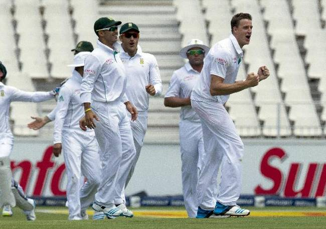 South Africa's bowler Morne Morkel, right, celebrates with teammates after dismissing India's batsman Murali Vijay for 8 runs during the first day of their cricket test match at Wanderers stadium in Johannesburg, South Africa, Wednesday, Dec. 18, 2013
