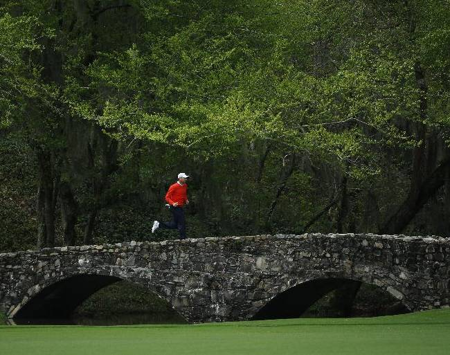 Sergio Garcia, of Spain, runs across the Byron Nelson Bridge during a practice round for the Masters golf tournament Tuesday, April 8, 2014, in Augusta, Ga