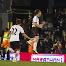 Fulham s Scott Parker, right, celebrates with teammate ElsadZverotic after scoring against Swansea City, during their English Premier League soccer match, at the Craven Cottage stadium in London, Saturday, Nov. 23, 2013