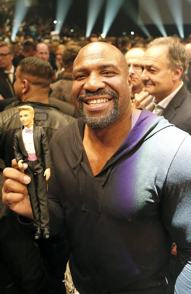 Former heavyweight world champion Shannon Briggs holds a doll after the IBF, WBA, WBO and IBO heavyweight world title bout between Wladimir Klitschko from Ukraine and his Samoan-born Australian challenger Alex Leapai in Oberhausen, western Germany, Saturday, April 26, 2014