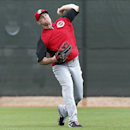 Cincinnati Reds right fielder Jay Bruce throws during spring training baseball practice in Goodyear, Ariz., Tuesday, Feb. 25, 2014 The Associated Press