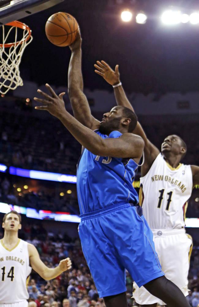 Nowitzki carries Mavs past Pelicans 100-97