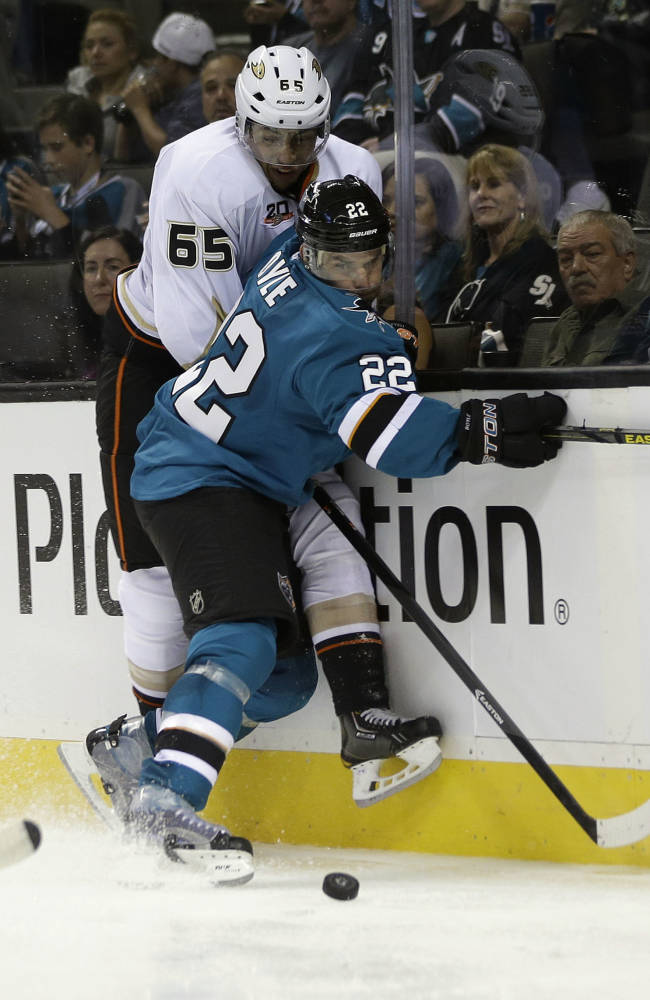 Anaheim Ducks right wing Emerson Etem (65) collides against the boards with San Jose Sharks defenseman Dan Boyle (22) during the second period of a preseason NHL hockey game on Friday, Sept. 20, 2013, in San Jose, Calif