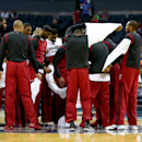 The Miami Heat huddle at center court as they take off their warm up jerseys before their game against the Charlotte Bobcats in Game Four of the Eastern Conference Quarterfinals during the 2014 NBA Playoffs at Time Warner Cable Arena on April 28, 2014 in Charlotte, North Carolina. (Photo by Streeter Lecka/Getty Images)