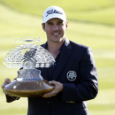 Brooks Koepka holds the trophy after winning the Phoenix Open golf tournament, Sunday, Feb. 1, 2015, in Scottsdale, Ariz. (AP Photo/Rick Scuteri)