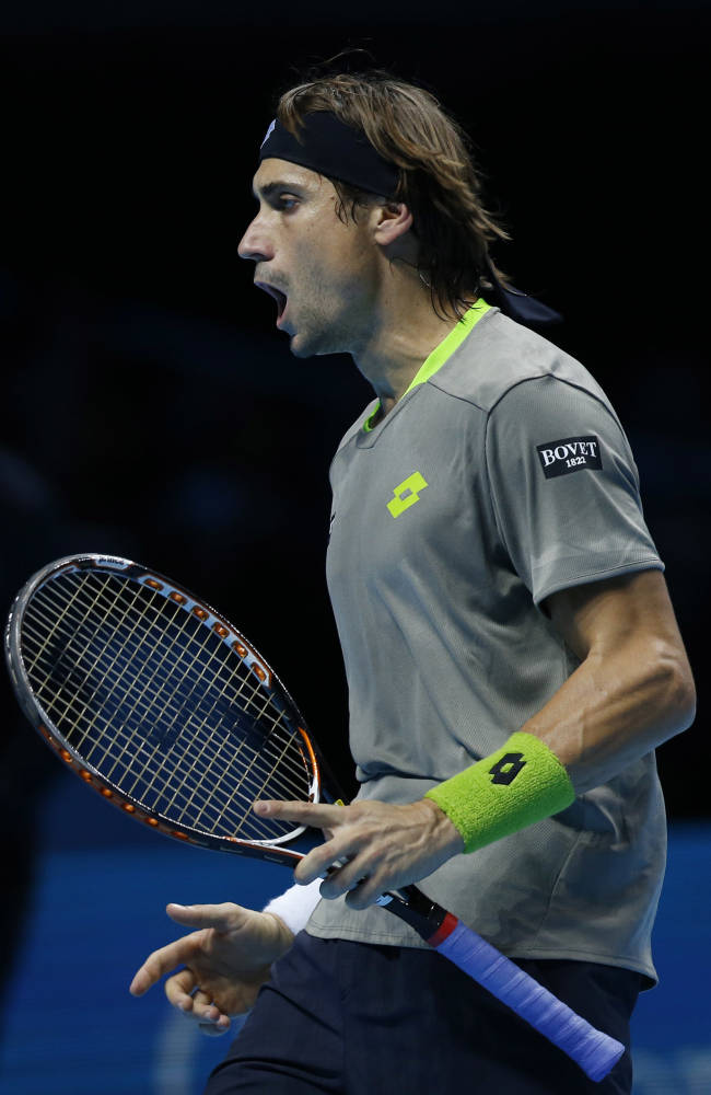 David Ferrer of Spain cries out after winning a point against Stanislas Wawrinka of Switzerland during their ATP World Tour Finals single tennis match at the O2 Arena in London Friday, Nov. 8, 2013