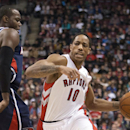 Toronto Raptors guard DeMar DeRozan drives past Atlanta Hawks forward DeMarre Carroll, left, during the first half of an NBA basketball game in Toronto on Sunday, March 23, 2014 The Associated Press