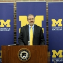 University of Michigan school President Mark Schlissel announces his acceptance of the resignation of athletic director Dave Brandon during a news conference in Ann Arbor, Friday afternoon, Oct. 31, 2014. Brandon's departure comes amid another disappointi