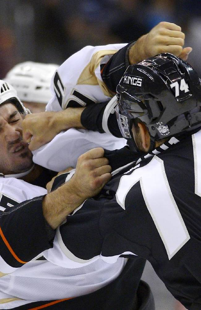 Los Angeles Kings center Dwight King, right, and Anaheim Ducks right wing Brad Staubitz fight during the first period of an NHL preseason hockey game, Tuesday, Sept. 24, 2013, in Los Angeles