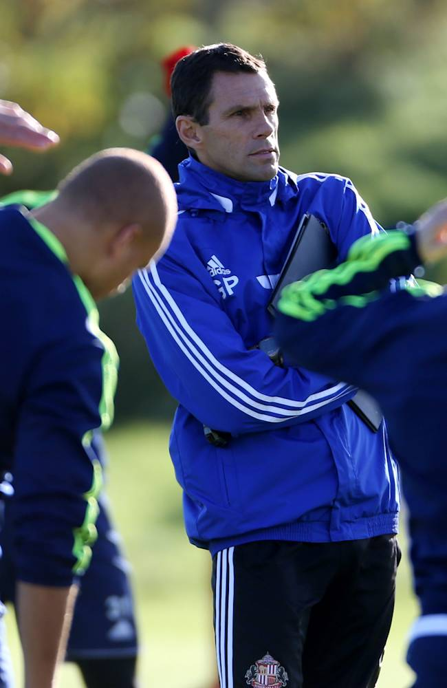 Sunderland's manager Gus Poyet, background centre, watches his squad,  during a training session at the club's training ground,  in Sunderland, England, Thursday Oct. 24, 2013. Sunderland will play Newcastle United in a Premier League match on Sunday