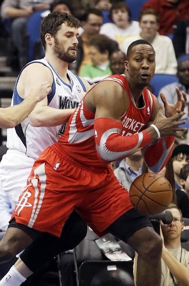 Houston Rockets' Dwight Howard, right, loses the ball as Minnesota Timberwolves' Kevin Love defends in the first quarter of an NBA basketball game, Monday, Feb. 10, 2014, in Minneapolis