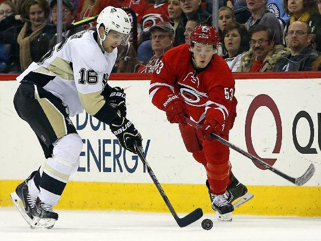 Carolina Hurricanes' Jeff Skinner (53) eyes the puck controlled by Pittsburgh Penguins' Brandon Sutter (16) during the second period of an NHL hockey game, Friday, Dec. 27, 2013, in Raleigh, N.C