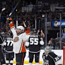 Anaheim Ducks left wing Patrick Maroon, left, celebrates a goal by defenseman Sami Vatanen, of Finland, as Los Angeles Kings goalie Jonathan Quick, right, reacts during the third period of an NHL hockey game, Saturday, Jan. 17, 2015, in Los Angeles The As