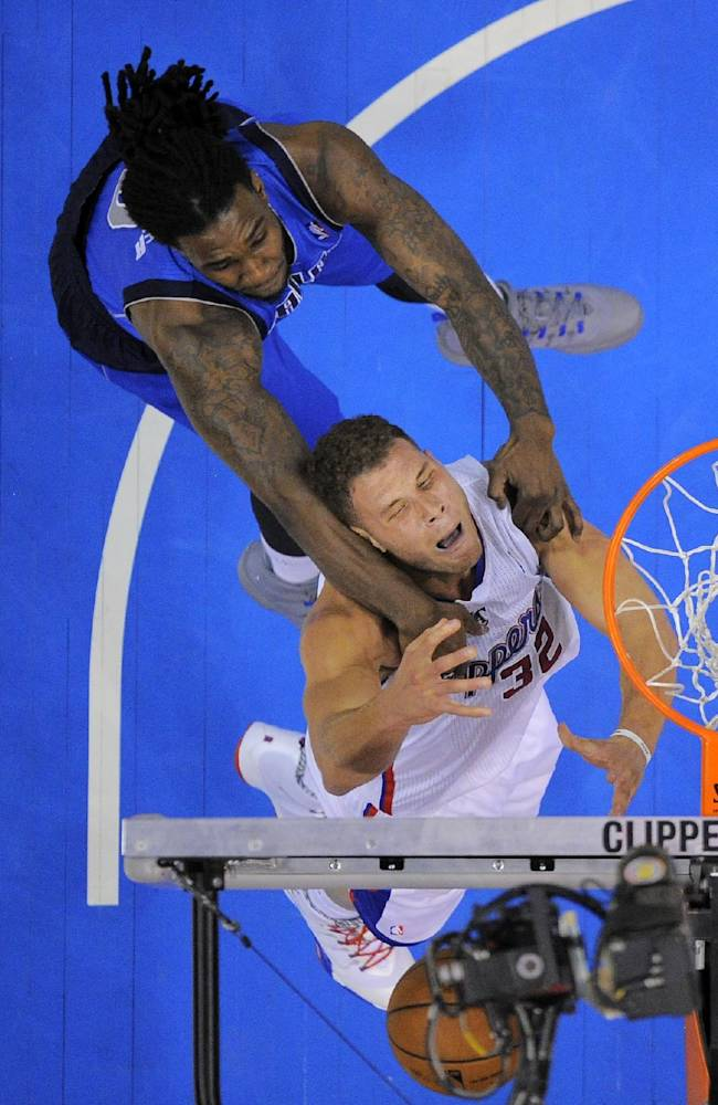 Dallas Mavericks forward Jae Crowder, top, fouls Los Angeles Clippers forward Blake Griffin during the half of an NBA basketball game, Wednesday, Jan. 15, 2014, in Los Angeles. The Clippers won 129-127
