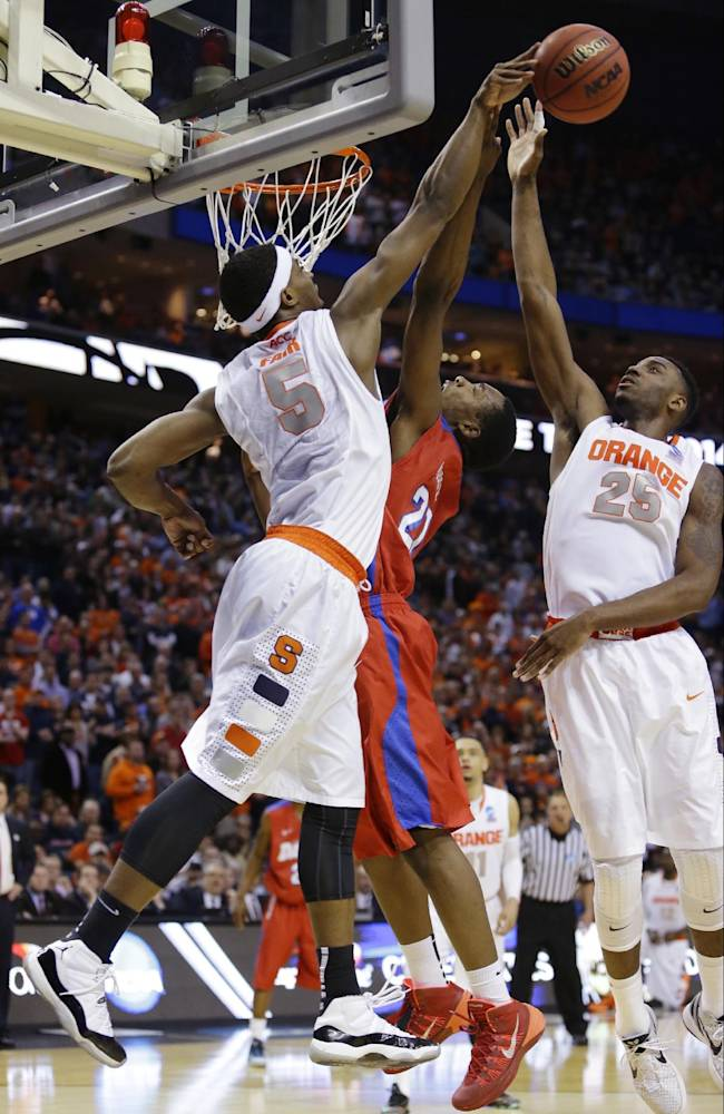 Syracuse's C.J. Fair (5) and Rakeem Christmas (25) block a shot by Dayton's Dyshawn Pierre (21) during the second half of a third-round game in the NCAA men's college basketball tournament in Buffalo, N.Y., Saturday, March 22, 2014
