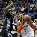 New York Knicks' Carmelo Anthony, right, drives around Minnesota Timberwolves' Dante Cunningham in the second half of an NBA basketball game, Wednesday, March 5, 2014, in Minneapolis. Anthony led the Knicks with 33 points in their 118-106 win The Associat