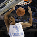 North Carolina's Kennedy Meeks dunks during the first half of an NCAA college basketball game against North Carolina Central in Chapel Hill, N.C., Friday, Nov. 14, 2014. (AP Photo/Gerry Broome)