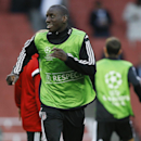 Besiktas' Demba Ba smiles during a training session at Emirates Stadium in London Tuesday, Aug. 26, 2014. Arsenal will play Besiktas in a Champions League qualifying soccer match at the stadium on Wednesday