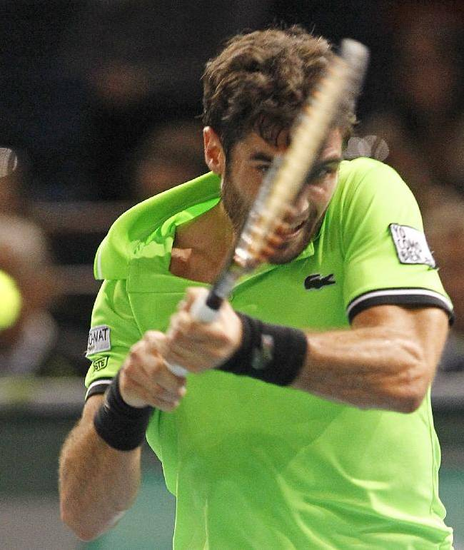 Spain's Pablo Andujar returns the ball to Canadian player Vasek Pospisil, during their second round match, at the Tennis Paris Masters, in the Paris Bercy stadium, Tuesday Oct. 29, 2013