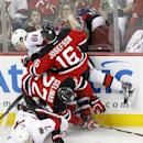 Ottawa Senators players Kyle Turris (7) and Mark Stone (61) collide with New Jersey Devils players Eric Gelinas (22) and Jacob Josefson (16), of Sweden, during the third period of an NHL hockey game, Wednesday, Dec. 17, 2014, in Newark, N.J. The Senators