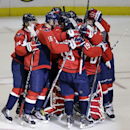 Washington Capitals teammates, including center Mikhail Grabovski (84), right wing Eric Fehr (16), center Nicklas Backstrom (19), and goalie Braden Holtby celebrate winning the shootout after an NHL hockey game against the Montreal Canadiens in Washington