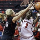 Rutgers' Kahleah Copper (2) takes a shot past Cincinnati's Kayla Cook (10) during the first half of an NCAA college basketball game Saturday, Feb. 9, 2013, in Piscataway, N.J. (AP Photo/Mel Evans)