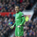 Leicester's goalkeeper Mark Schwarzer shouts to his teammates during the English Premier League soccer match between Manchester United and Leicester at Old Trafford Stadium, Manchester, England, Saturday Jan. 31, 2015