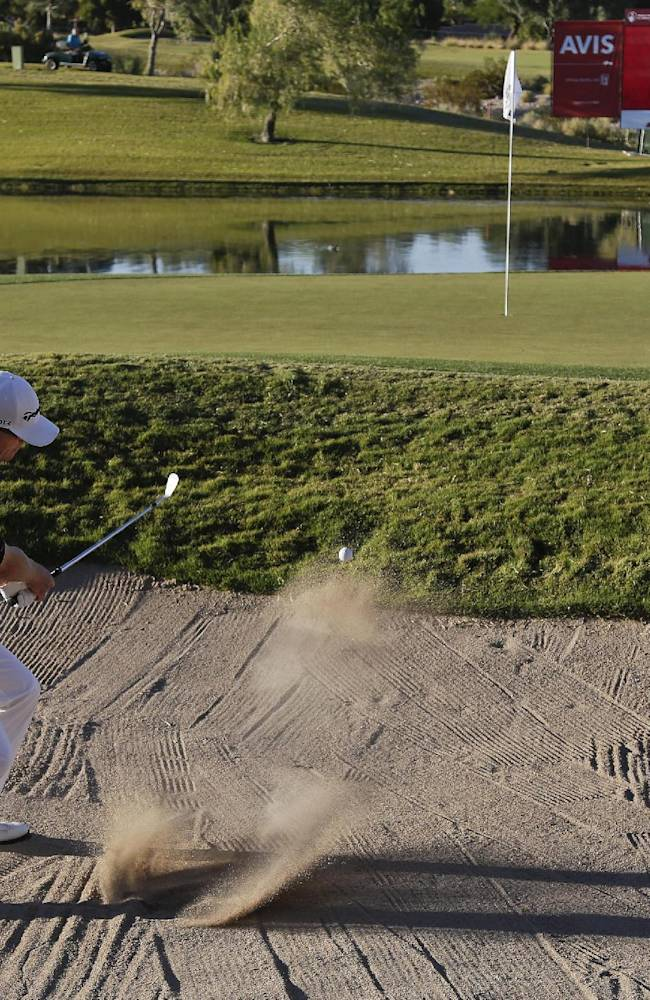 John Senden hits out of the bunker on the 17th hole in the third round of the Shriners Hospitals for Children Open golf tournament, Saturday, Oct. 19, 2013, in Las Vegas