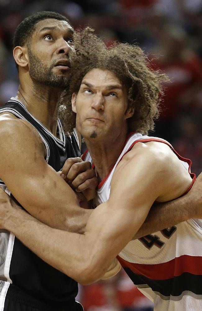 Portland Trail Blazers' Robin Lopez, right, and San Antonio Spurs' Tim Duncan, left, battle under the boards in the second half during Game 3 of a Western Conference semifinal NBA basketball playoff series Saturday, May 10, 2014, in Portland, Ore. The Spurs won 118-103
