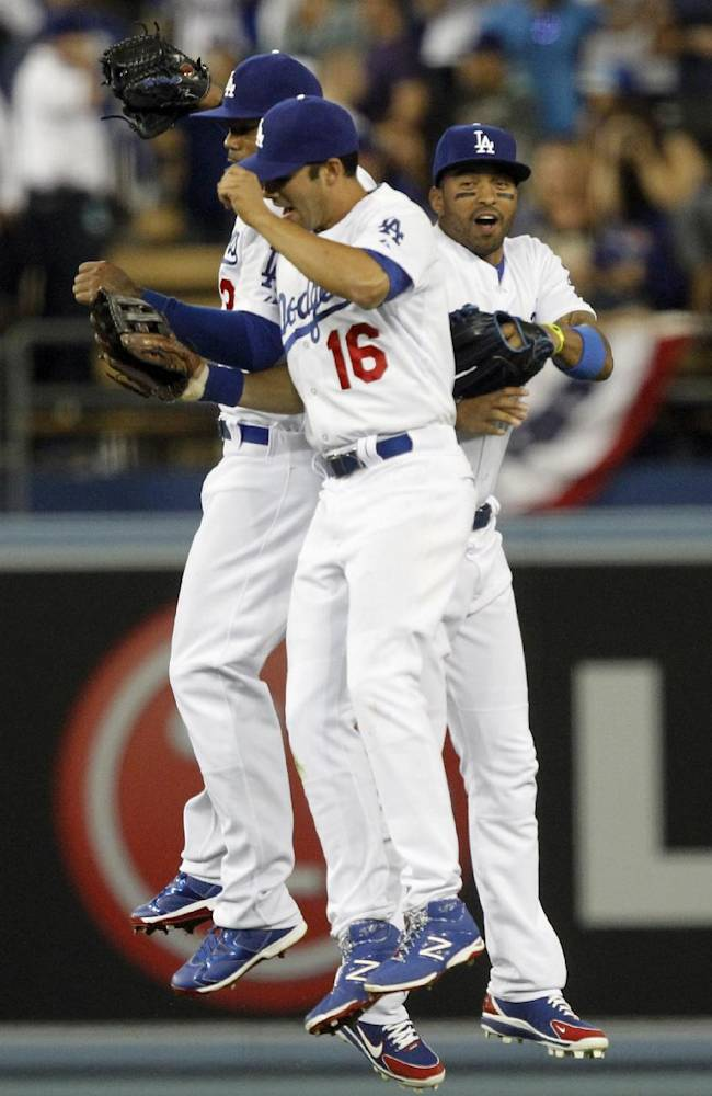 Los Angeles Dodgers left fielder Carl Crawford, left, right fielder Andre Ethier (16) and center fielder Matt Kemp, right, celebrate after the Dodgers defeated the San Francisco Giants 6-2 in a baseball game Sunday, April 6, 2014, in Los Angeles