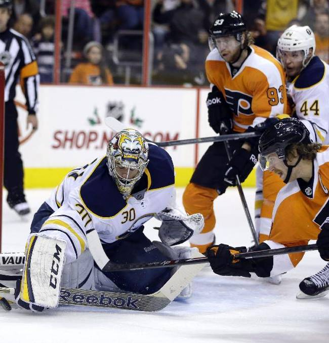 Buffalo Sabres' Ryan Miller (30) blocks a shot by Philadelphia Flyers' Claude Giroux (28) as Jakub Voracek (93), of Czech Republic, Brayden McNabb (44) and Mikhail Grigorenko (25), of Russia, stand by during the second period of an NHL hockey game Thursday, Nov. 21, 2013, in Philadelphia