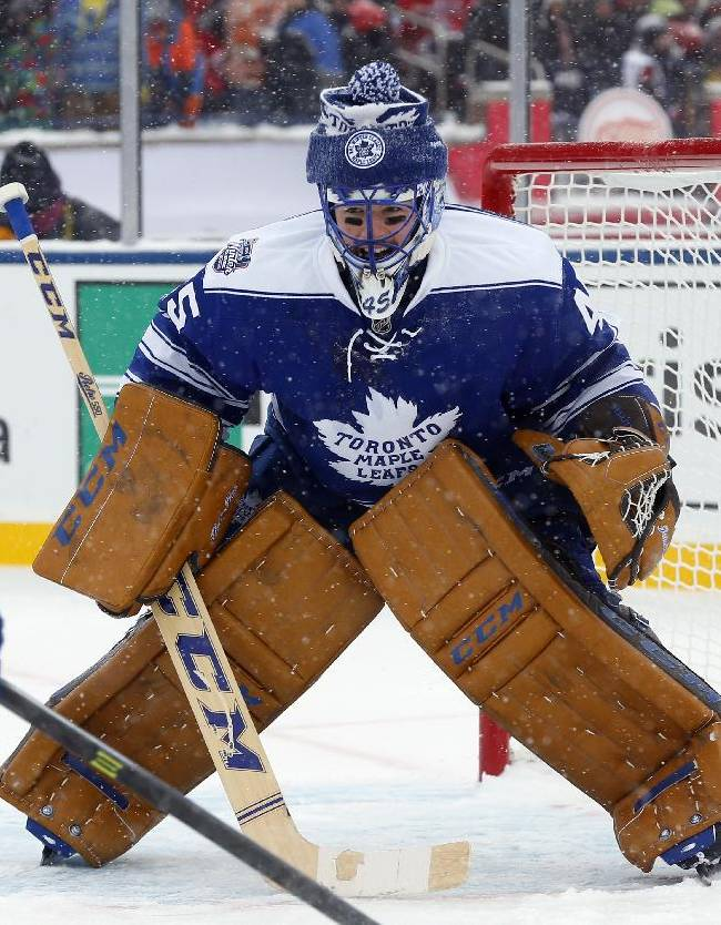 Toronto Maple Leafs goalie Jonathan Bernier (45) guards the net during the second period of the Winter Classic outdoor NHL hockey game against the Detroit Red Wings at Michigan Stadium in Ann Arbor, Mich., Wednesday, Jan. 1, 2014