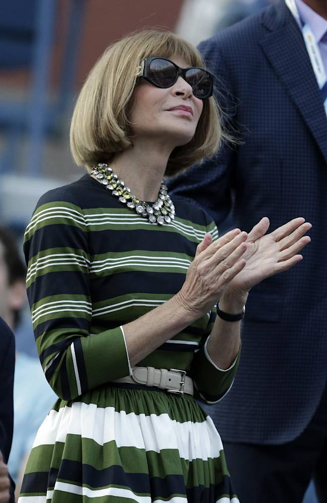 Anna Wintour waits for the start of a match between Roger Federer, of Switzerland, and Marinko Matosevic, of Australia, in the first round of the 2014 U.S. Open tennis tournament Tuesday, Aug. 26, 2014, in New York