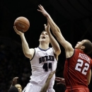 Butler center Andrew Smith (44) is fouled by Richmond guard Kendall Anthony (0) as he shoots over forward Greg Robbins (22) in the first half of an NCAA college basketball game in Indianapolis, Wednesday, Jan. 16, 2013. (AP Photo/Michael Conroy)
