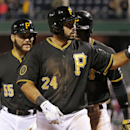 Pittsburgh Pirates' Pedro Alvarez (24) celebrates after hitting a three-run home run off Milwaukee Brewers starting pitcher Wei-Chung Wang during the eighth inning of a baseball game in Pittsburgh, Thursday, April 17, 2014. The Pirates won 11-2 The Associ
