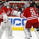 Carolina Hurricanes goalie Anton Khudobin (31) replaces goalie Cam Ward (30) after the New York Islanders score their third goal during the first period of an NHL hockey game in Raleigh, N.C., Tuesday, March 25, 2014 The Associated Press